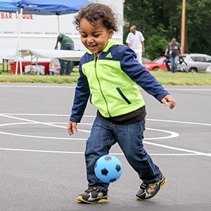 Young boy happy and playing soccer